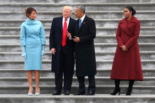 President Donald Trump and former president Barack Obama stand on the steps of the Capitol in Washington (Rob Carr/Pool Photo via AP)