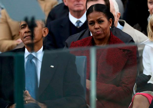 Outgoing U.S. first lady Michelle Obama listens with outgoing President Barack Obama (L) to incoming President Donald Trump speak during inauguration ceremonies at the U.S. Capitol in Washington, U.S., January 20, 2017. REUTERS/Carlos Barria