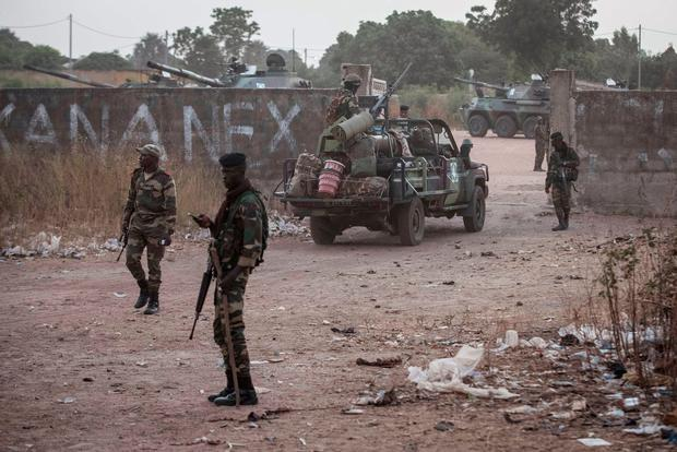 Senegal soldiers providing security at their gathering point on the Gambia boarder with Senegal at the town of Karang, Senegal, Friday, Jan. 20, 2017. (AP Photo/Sylvain Cherkaoui)