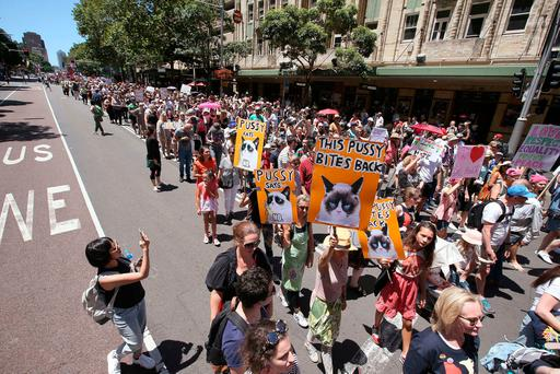Thousands file through the streets during the Women's March in Sydney, Australia, Saturday, Jan. 21, 2017. Protesters at the Women's March rally carried placards with slogans including
