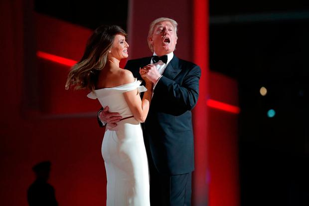 U.S. President Donald Trump sings to the song