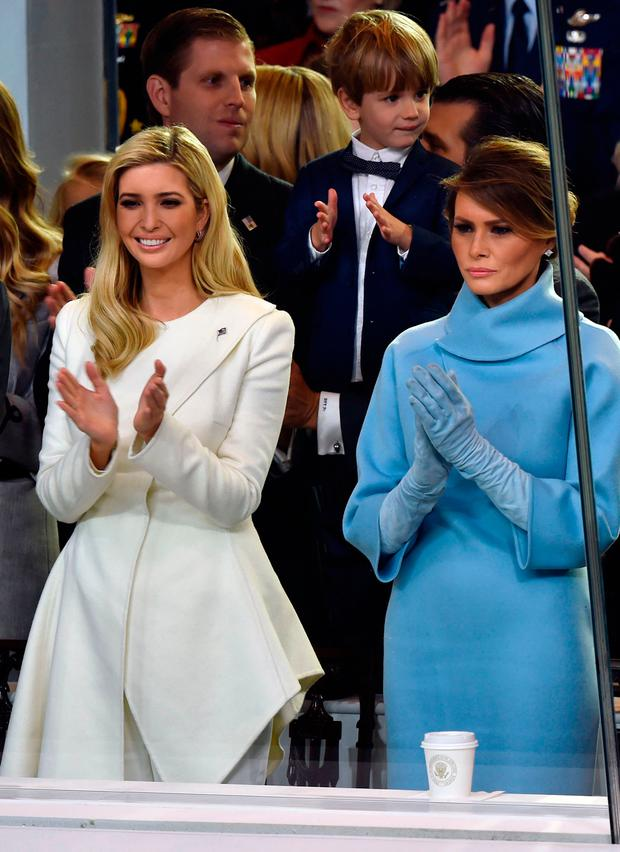 US First Lady Melania Trump and Ivanka Trump applaud during the presidential inaugural parade on January 20, 2017