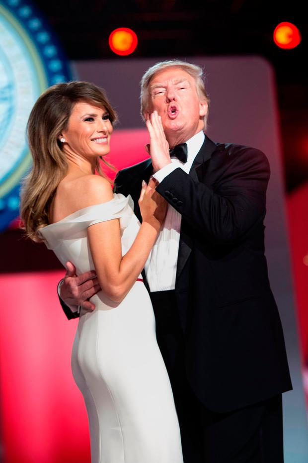US President Donald Trump tells the crowd he loves them while dancing with US first lady Melania Trump during the Freedom Ball January 20, 2017