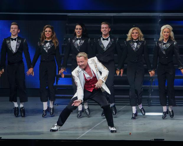 Michael Flatley and company perform on stage during the