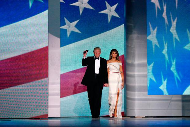 U.S. President Donald Trump and first lady Melania Trump, with Vice President Mike Pence and his wife and the Trump family, attend the Freedom Ball in honor of his inauguration in Washington, U.S. January 20, 2017. REUTERS/Jonathan Ernst