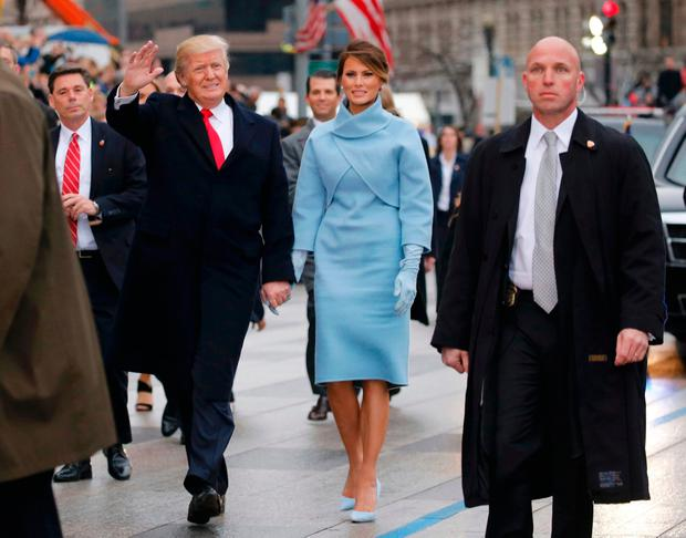 U.S. President Donald Trump and first lady Melania Trump walk along Pennsylvania Avenue during the inaugural parade from the U.S. Capitol in Washington, U.S., January 20, 2017. REUTERS/Jonathan Ernst