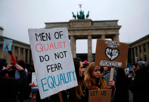 People gather in front of the U.S. Embassy on Pariser Platz beside Brandenburg Gate in solidarity with women's march in Washington and many other marches in several countries, in Berlin, Germany, January 21, 2017. REUTERS/Hannibal Hanschke