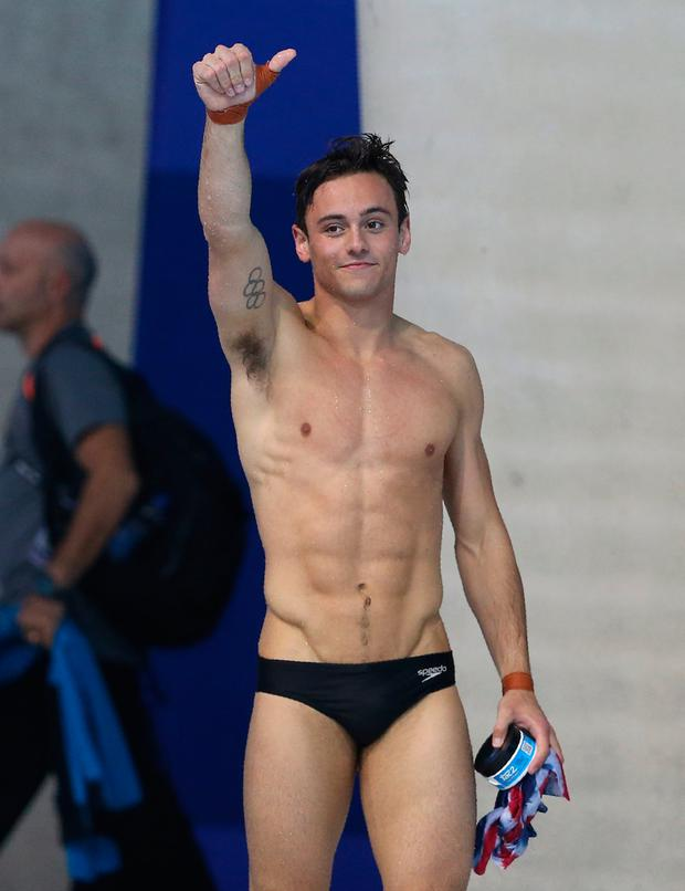 Britain's Thomas Daley celebrates after taking gold in the final of the men's Platform diving event on Day 7 of the European aquatics championships in London