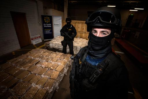 Armed Gardai protect an estimated €37.5 million worth of Cannabis herb which was seized by Revenue and Gardaí at Dublin Port. Pic:Mark Condren