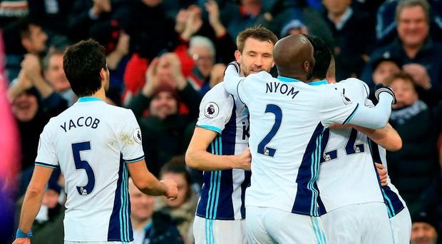 West Bromwich Albion's Chris Brunt (right) celebrates scoring his side's second goal of the game with team mates during the Premier League match at The Hawthorns