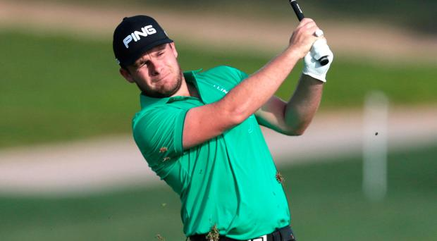 Tyrrell Hatton of England shoots for the green during the Abu Dhabi HSBC Golf Championship. Photo: Reuters