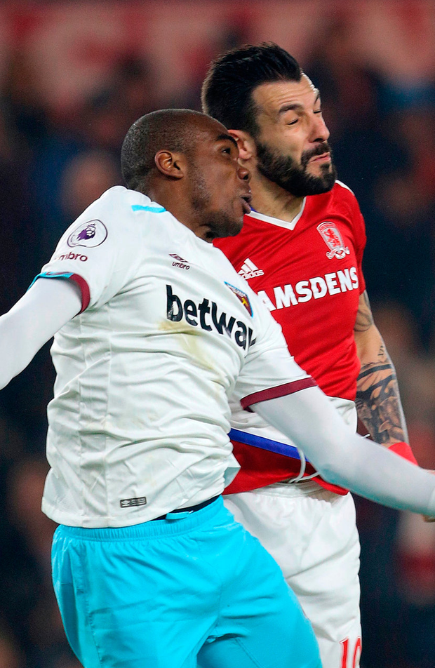 West Ham United's Angelo Ogbonna (left) and Middlesbrough's Alvaro Negredo battle for the ball. Photo: Richard Sellers/PA