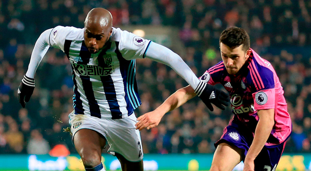 West Bromwich Albion's Allan Nyom (left) and Sunderland's George Honeyman battle for the ball. Photo: Nigel French/PA