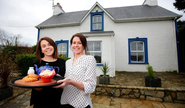 Tea for two: Sisters Claire and Stephanie Kee outside their café in Killybegs. Photo: Gerry Mooney