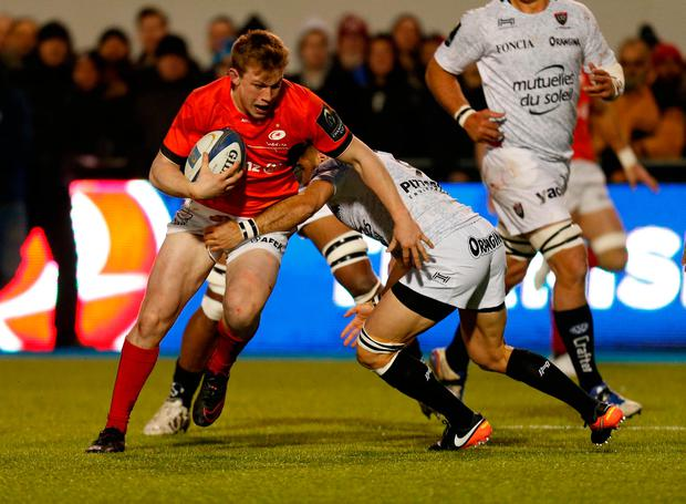 Saracens' Nick Tompkins and Toulon's Sebastien Tillous-Borde. Photo: PA