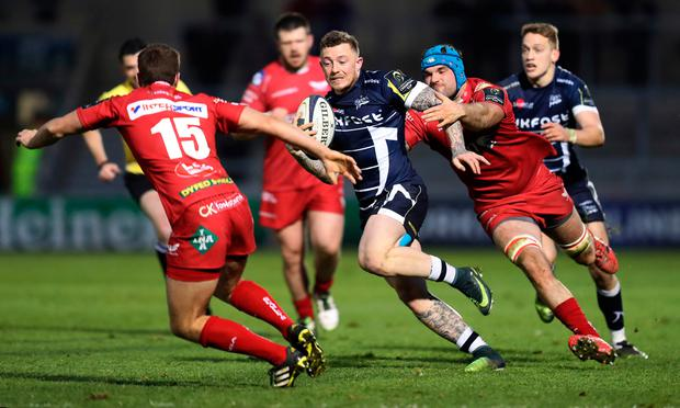 Josh Charnley of Sale Sharks in action with Aled Thomas and Tadhg Beirne of Scarlets. Photo: Reuters