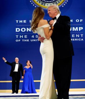 US President Donald Trump dances with his wife Melania as Vice President Mike Pence and his wife Karen wave Photo: REUTERS/Yuri Gripas