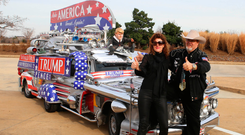 Mad machine: Barbara McCarthy, Pastor Martti and the Trumpmobile at Arlington Cemetery