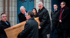 Mourners: Ronan Fanning's children Judith, Gareth and Tim follow their father's coffin Photo: Mark Condren