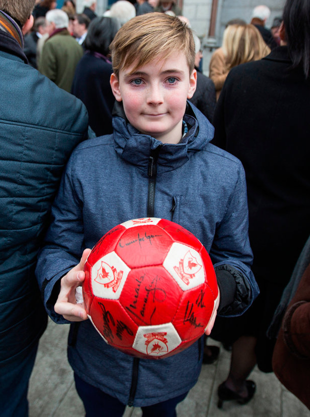Grandson Daniel with a signed football Photo: Mark Condren