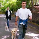 Roy Keane walks Triggs, the family dog, near his home on May 25, 2002 - days after being sent home from Saipan Photo: REUTERS/Ian Hodgson