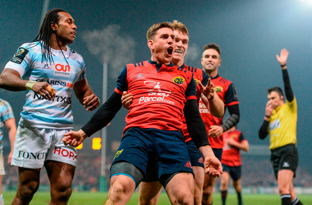 Ian Keatley celebrates with team-mate Rory Scannell after scoring Munster's third try. Photo: Sportsfile