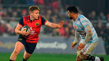 Munster's Rory Scannell fends off So'otala Fa'aso'o. Photo: Sportsfile