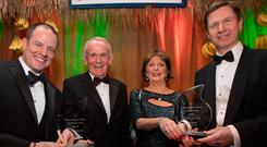 Charity: Gregory Grene (left) and Timothy Perutz (right), are presented with the prestigious William Jefferson Clinton Goodwill for Haiti Award by Leslie and Carmel Buckley (centre) Photo: Fergal Phillips