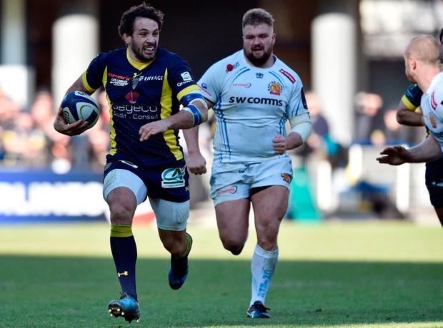Clermont's French centre Remi Lamerat(L) runs with the ball for a try. Photo: Getty