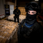 Haul: Armed gardai protect an estimated €40m worth of marijuana which was seized by Customs and gardai at Dublin Port