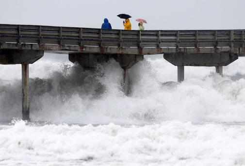 'Certainly, stormy weather may wreak havoc on land - but it is especially lethal at sea, turning waves into weapons of destruction' Photo: REUTERS/Mike Blake