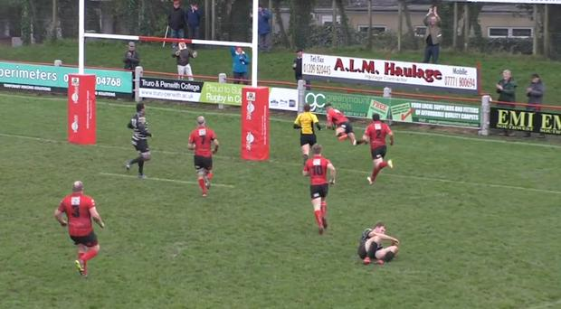 Alex Ducker dives over to score his try