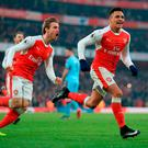 Arsenal's Alexis Sanchez celebrates scoring a penalty for his side during the Premier League match at The Emirates