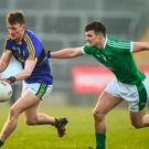 Tom O'Sullivan of Kerry in action against Paul White of Limerick during the McGrath Cup Final