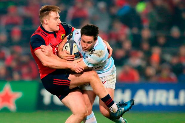 Racing 92's French centre Henry Chavancy (R) is tackled by Munster's Irish hooker Niall Scannell. Photo: Getty Images