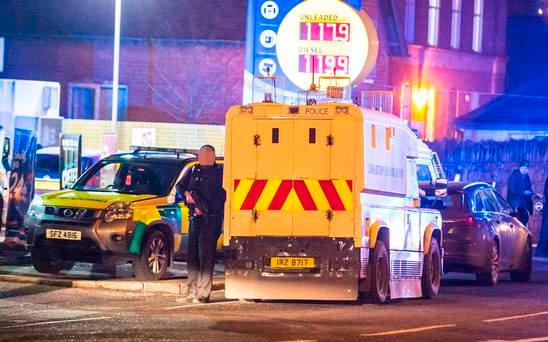 Police officers rush to the scene after an officer is shot on the Crumlin Road on 22th January 2017 (Photo - Kevin Scott / Belfast Telegraph)