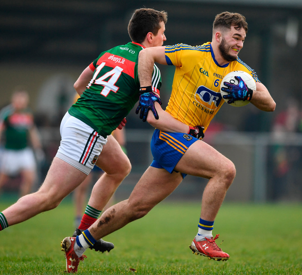 Roscommon's Ultan Harney is tackled by Cillian OConnor of Mayo during the match at St. Brigids GAA Club. Photo: Ramsey Cardy/Sportsfile
