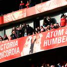 Banner of Arsenal's Alexis Sanchez and his dogs in the stands