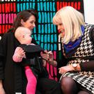 Mary Mitchell O'Connor, right, with Orla Keane-Grant and baby Niamh at the opening of the Showcase Expo in Dublin yesterday. Photo: Sasko Lazarov/Photocall