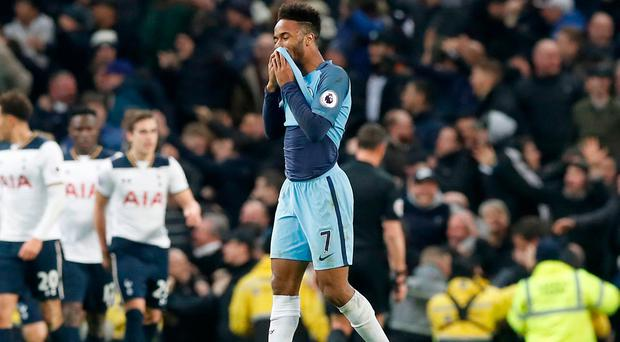 Manchester City's Raheem Sterling looks dejected after Tottenham Hotspurs score their first goal of the game. Photo credit: Martin Rickett/PA Wire
