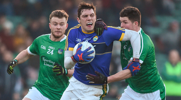 Kerry's David Moran evades the attentions of Limerick's Jamie Lee, left, and Iain Corbett. Photo: Diarmuid Greene/Sportsfile