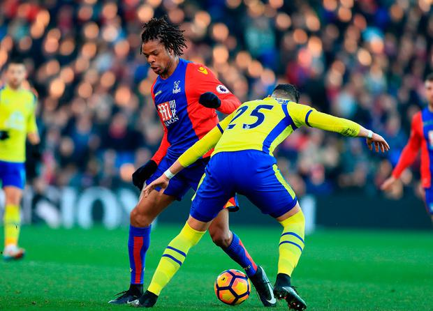 Crystal Palace's Loic Remy (left) and Everton's Ramiro Funes Mori in action. Photo credit: John Walton/PA Wire
