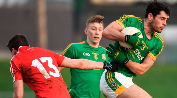 Meath's Donal Keogan in action against Conal McKeever of Louth during the Bord na Mona O'Byrne Cup semi-final. Photo: David Fitzgerald/Sportsfile