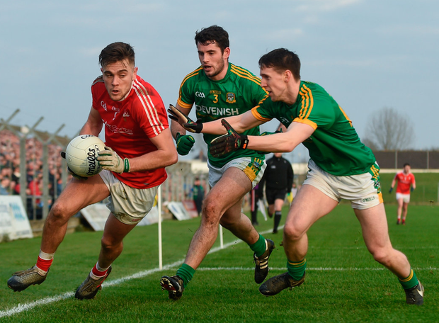 Louth's Andy McDonnell bids to escape Donal Keogan, left, and Cian O'Brien of Meath. Photo: David Fitzgerald/Sportsfile