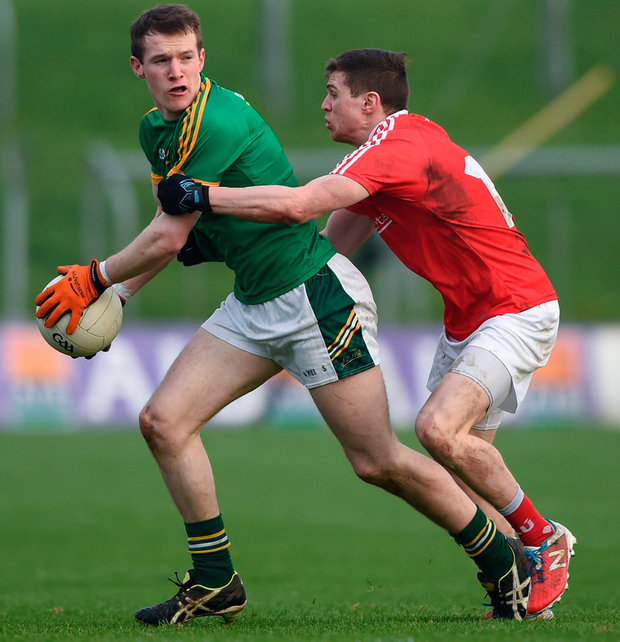 Meath's David McQuillan in action against Louth's Conal McKeever. Photo: David Fitzgerald/Sportsfile