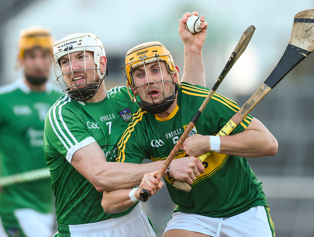 Limerick's Seamus Hickey battles with John Griffin of Kerry during the Co-Op Superstores Munster Senior Hurling League match. Photo: Diarmuid Greene/Sportsfile