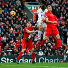 Fernando Llorente rises highest above the Liverpool defence to score his second goal in Swansea's win at Anfield. Photo: Reuters / Ed Sykes