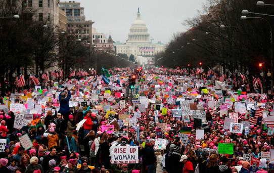 Protesters walk during the Women's March on Washington, with the U.S. Capitol in the background. Photo by Mario Tama/Getty Images