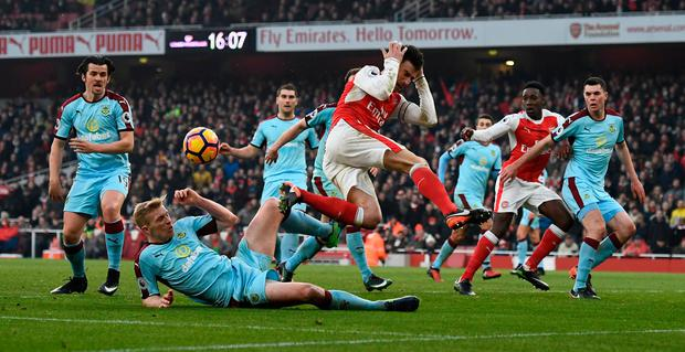 Arsenal's Laurent Koscielny is fouled by Burnley's Ben Mee in the area resulting in a penalty to Arsenal. Photo: Reuters / Dylan Martinez