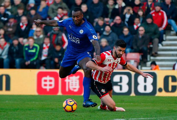 Southampton's Shane Long is fouled by Leicester City's Wes Morgan in the area resulting in a penalty to Southampton. Photo: Reuters / Paul Childs